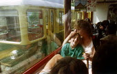 Mother and son sitting on a busy train, looking out of the window, Switzerland - Paul Carter - 18-08-1991