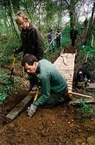 Volunteers building a wooden bridge. - Paul Carter - 03-05-1994