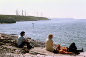 Workers relaxing during their lunch break on the coast of Cumbria.  This windfarm supplies 3,800 homes and saves 15,225 tonnes of green house gasses a year. - Paul Carter - 17-07-2000
