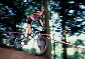 Riding down a steep hill in the woods during a mountain bike race. - Paul Carter - 04-08-1996