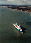 Aerial view of the NSL cruise ship Norway being towed by red tugs along Southampton Water - Paul Carter - 04-10-1996