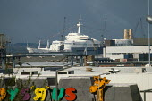 Looking past Toysrus Superstore, to a P&O Cruise liner waiting in the docks. Southampton, Hampshire. - Paul Carter - 19-06-2002