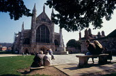 Tourists sitting in front of Winchester Cathedral. - Paul Carter - 17-08-1999