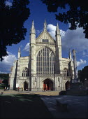 Exterior views of Winchester Cathedral, looking through Yew trees. - Paul Carter - 18-08-1999
