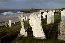 Graveyard next to the sea. North Cornwall. - Paul Carter - ,1980s,1988,beach,BEACHES,burial,buried,cemeteries,cemetery,church,churches,COAST,coastal,coastline,coastlines,coasts,cross,death,DEATHS,died,ENI environmental issues,grave,graves,Graveyard,Graveyards