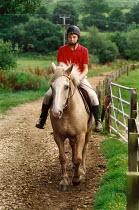 Boy riding a horse. - Paul Carter - 01-08-1988