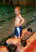 Boys playing during a pool party, getting ready to jump into the water. - Paul Carter - 11-08-2002