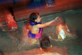Young girl, playing in the learner's swimming pool. - Paul Carter - 11-08-2002
