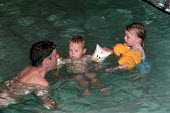 Two young children, playing in the learner pool with their father. - Paul Carter - 11-08-2002