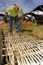 Making a wattle fence. - Paul Carter - 20-05-2000