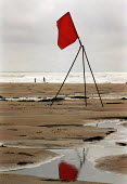 Red flag flying on a beach in Sandymouth Corwall on a windy day. - Paul Carter - 1990s,1993,beach,BEACHES,breakers,coast,coastal,coastline,coastlines,coasts,danger,dangerous,ENI environmental issues,EXERCISE,flying,hazard,hazardous,HAZARDS,holiday,holiday maker,holiday makers,holi