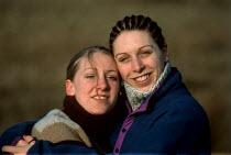 Portrait of two sisters, hugging. - Paul Carter - 22-03-1998
