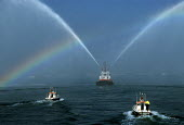 Fireboat spraying jets of water, creating a rainbow. - Paul Carter - 20-09-1997