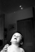 Young boy playing with bubbles. - Paul Carter - 13-09-2001