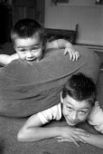 Two brothers, in their lounge at home. - Paul Carter - 13-09-2001