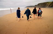 A group of friends and family walking across the beach at Sandymouth near Bude, Cornwall. - Paul Carter - 10-08-1993