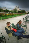 Couple relaxing on chairs in a park. - Paul Carter - 23-09-2001