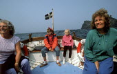 A family boat trip to Long Island, nr. Boscastle, Cornwall. - Paul Carter - 1980s,1989,activity,adult,adults,belts,boat,boats,child,CHILDHOOD,children,coast,coastal,coastline,coastlines,coasts,cornish,day out,day trip,families,family,female,females,FERRIES,ferry,generations,g