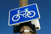 Bright blue cycle lane road sign. - Paul Carter - 04-09-2003