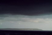 View of the west of Isle of Wight and The Needles - as seen from the mainland, Hampshire. Under black storm clouds. - Paul Carter - 02-10-2003