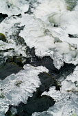 Sections of ice frozen over a fast flowing stream. - Paul Carter - 2000s,2003,abstract,conservation,country,countryside,eni,ENI environmental issues,environment,Environmental Issues,flow,flowing,formation,freezing,frozen,hill,hills,ice,landscape,LANDSCAPES,National P