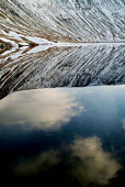 Snow covered hills reflect into the still water of a lake. The Lake District. - Paul Carter - 02-01-2004