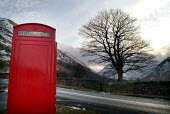 Bright red telephone box on the side of a road. The Lake District - Paul Carter - 02-01-2004