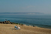 Sitting on the beach, relaxing. Looking out over to the Isle of Wight and the Needles. Milford-on-Sea, Hampshire. - Paul Carter - 29-05-2003