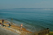 Two men fishing on the edge of the beach at Milford-on-Sea, Hampshire. - Paul Carter - 29-05-2003