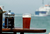 A pint of beer and on a table in a pub garden. - Paul Carter - 27-07-2004