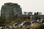 Tourists walking out to Pulpit Rock, created by quarrying. Portland Bill, Dorset. - Paul Carter - 14-02-2004