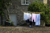 Washing drying on a line in a garden in the village of Purbeck. - Paul Carter - 03-08-2004
