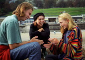 Brother and sisters sitting on a beach, playing slap hands. Cornwall. - Paul Carter - 06-10-1993