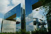 Reflection of clouds in the windows of a modern office block. Parc Citroen, Paris. - Paul Carter - 15-05-2004