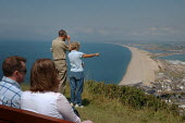 Couples admiring the view from the viewpoint on top of the hill at Castletown, Fortunesewell, Isle of Portland. Dorset. - Paul Carter - 13-07-2004