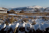 Snow covered farm building. The Lake District. - Paul Carter - 2000s,2004,building,BUILDINGS,cold,conservation,country,countryside,desolate,dry,eni,ENI environmental issues,environment,Environmental Issues,farm,hills,house,houses,landscape,LANDSCAPES,mountain,mou