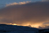 Dramatic sunset over a snow covered hill. The Lake District. - Paul Carter - 26-12-2004