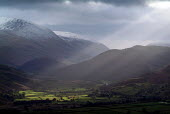 Shafts of sunlight over Keswick and Derwent Water viewed from Little Man. The Lake District. - Paul Carter - 28-12-2004