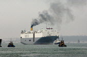 UECC car transporter ship entering Southampton harbour docks with the help of tugs. - Paul Carter - 17-05-2006
