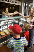 Buying ice creams from a ice cream parlour on a hot day. - Paul Carter - 05-06-2006
