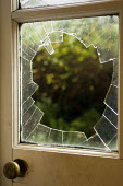 A window broken by someone who tried to break in to a house. - Paul Carter - 14-10-2005