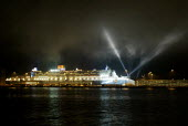 View of the QM2 with searchlights. - Paul Carter - 07-01-2004