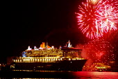 Brightly coloured fireworks over the QM2, as she leaves Southampton at the start of her maiden voyage. - Paul Carter - 12-01-2004