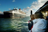 Onlookers taking photographs of the passenger liner, The Cunard Queen Mary 2, docked in Southampton on the day of her maiden voyage. - Paul Carter - 12-01-2004