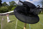 Summer hat hanging on end of a badminton net. - Paul Carter - 10-06-2005