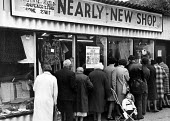Queue waiting for the Nearly New Shop to open, in Coventry. - John Sturrock - 1970s,1975,baby babies,buy,buyer,buyers,buying,charity shop,child children,city urban,clothes clothing,commodities,commodity,consumer,consumers,customer,customers,display,displays,DOWNTURN,EBF Economy