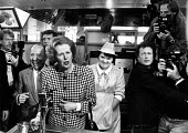 Margaret Thatcher campaiging in May before the 1987 general election. Here with Lord Faste at the South MIMMs services (A1/M25). - John Sturrock - 1980s,1987,Camera,cameras,Campaign,Campaigning,campaigns,catering,communicating,communication,conservative,Conservative Party,conservatives,conversation,DEMOCRACY,dialogue,ELECTION,elections,EMOTION,E
