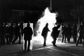 Petrol bomb on Upper Parliament St, as part of the Toxteth Riots, in Liverpool. - John Sturrock - 1980s,1981,adult,adults,BME Black minority ethnic,bomb,bombs,burn,burning,BURNS,cities,city,civil,CLJ,Danger,dangerous,disorder,disturbance,fire,fires,force,hazard,hazardous,HAZARDS,inner-city,line,li