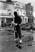 Rioter with fire extinguisher, Upper Parliament Street,Toxteth Riots, Liverpool - John Sturrock - ,1980s,1981,BAME,BAMEs,Black,BME,BME Black minority ethnic,bmes,cities,city,civil,Danger,dangerous,disorder,disturbance,diversity,ethnic,ethnicity,fire,fire extinguisher,fire extinguishers,fires,hazar