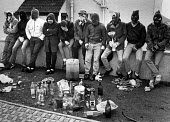 Loyalist one day strike against Anglo-Irish agreement. Youths and petrol bomb equipment in the Tyndale estate at Ballysillam. - John Sturrock - 1980s,1986,against,bomb,bombs,bottle,bottles,cities,city,device,devices,disputes,equipment,friend,friends,friendship,friendships,group,groups,hat,hats,incendiary,INDUSTRIAL DISPUTE,Loyalist,Loyalists,